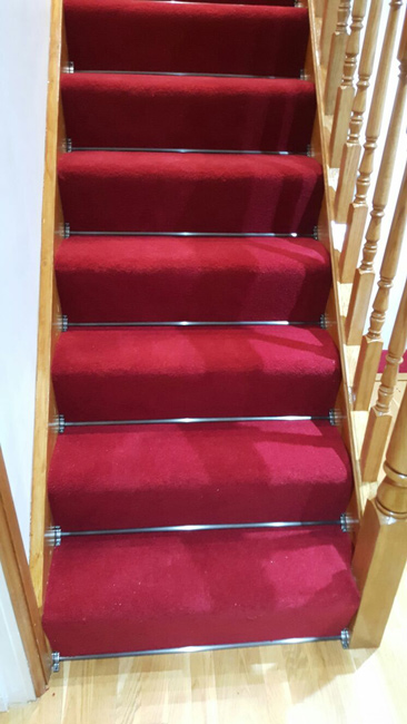 portfolio-carpets-lucious-red-carpet-with-stair-rods-01