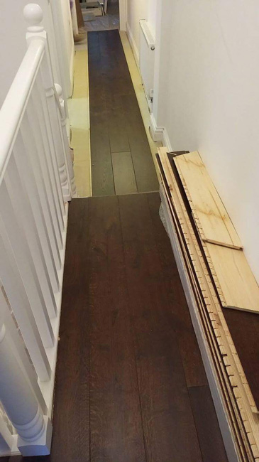 portfolio-straight-plank-wood-installation-into-bedroom-and-hall-01