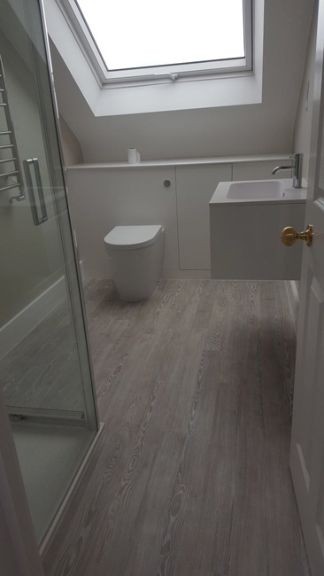 portfolio smooth floors amtico grey wood effect bathroom and bedroom 01
