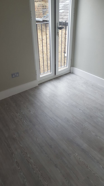 portfolio smooth floors amtico grey wood effect bathroom and bedroom 02