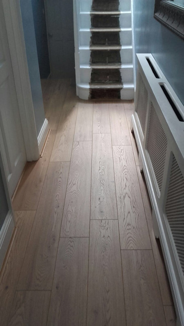 Hallway in plank wooden flooring the flooring group for Hardwood flooring suppliers