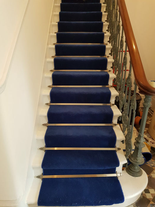 portfolio blue stair carpet as a runner with bronze stair rods 06