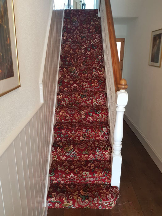 portfolio patterned red stair carpet 01