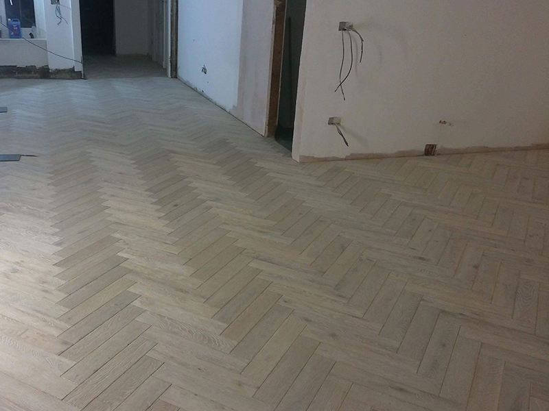 White Oak Herringbone Flooring Installation In Mayfair