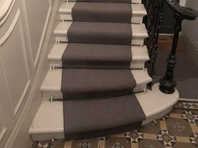 Grey Carpet With Rods Installed In Pimlico