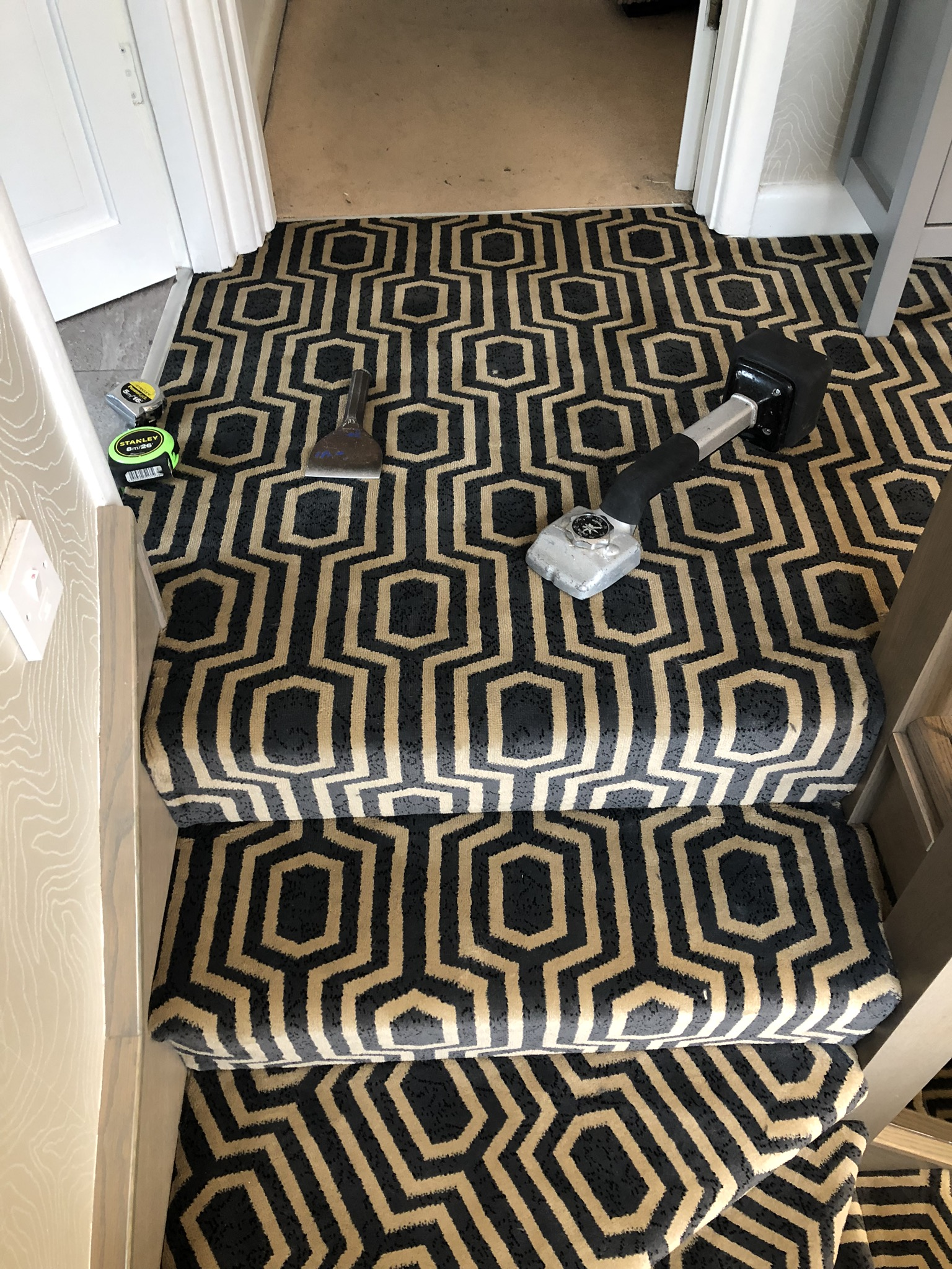 Black Axminster carpet installed in Acton 4