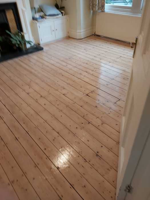 Sand and Seal Selected Areas of Wood Flooring Installed in Barnes 2