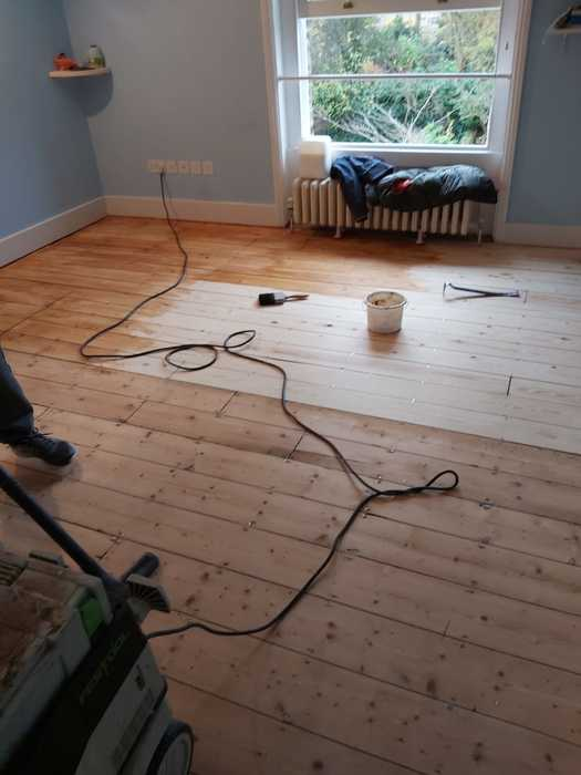 Sand and Seal Selected Areas of Wood Flooring Installed in Barnes 3