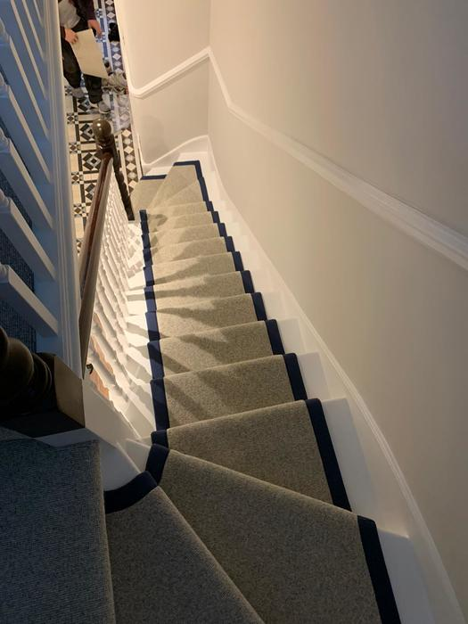 White Carpet with black border on Stairs Installed in Islington 4