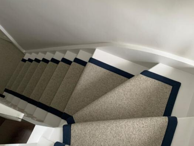 White Carpet with Black Border on Stairs Installed in Islington