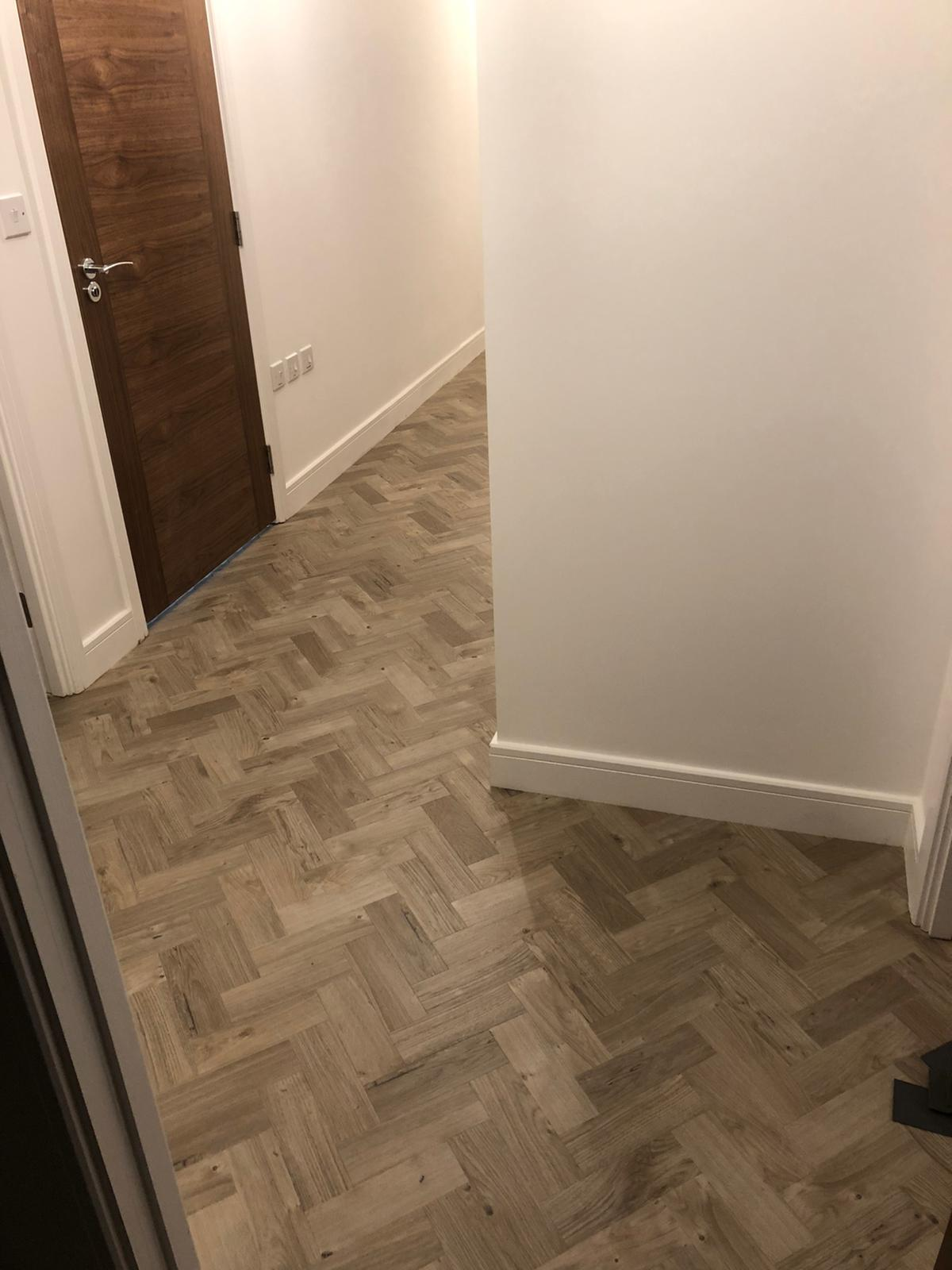 To supply & install Amtico Spacia Sun Bleached Oak luxury vinyl flooring in Kilburn 1