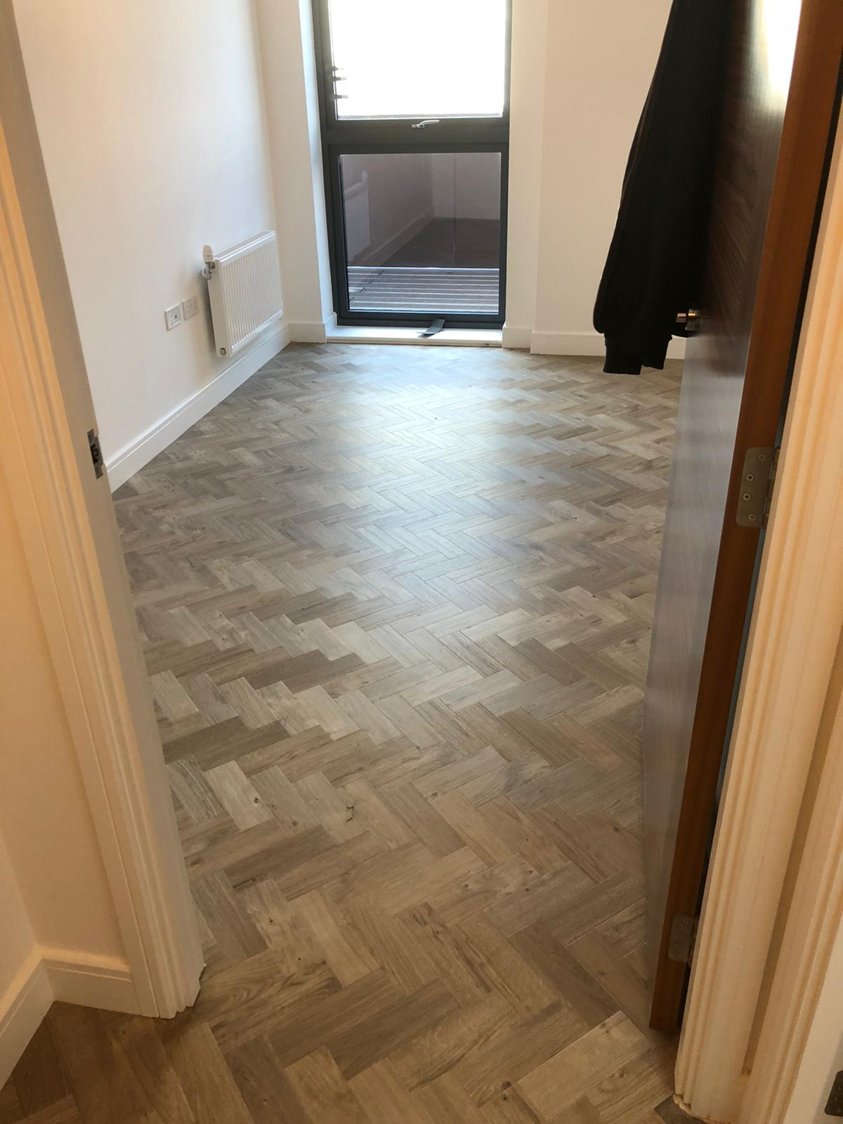 To supply & install Amtico Spacia Sun Bleached Oak luxury vinyl flooring in Kilburn 2