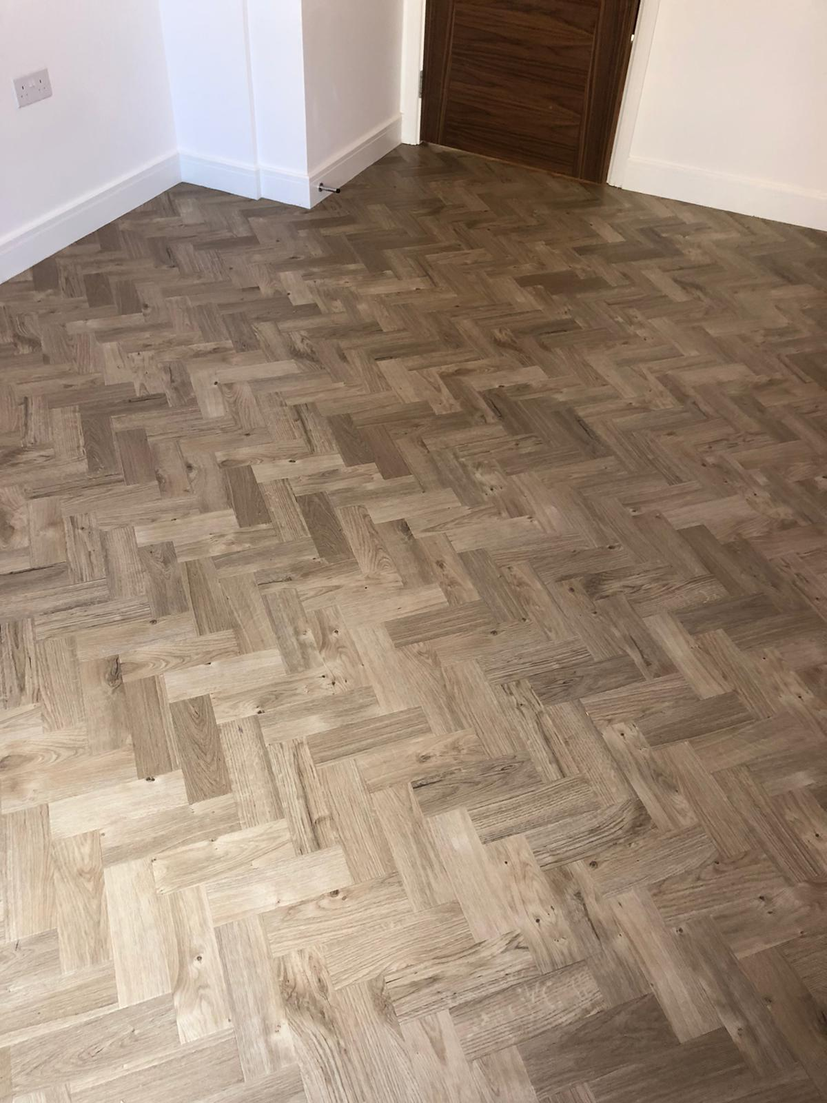 To supply & install Amtico Spacia Sun Bleached Oak luxury vinyl flooring in Kilburn 3