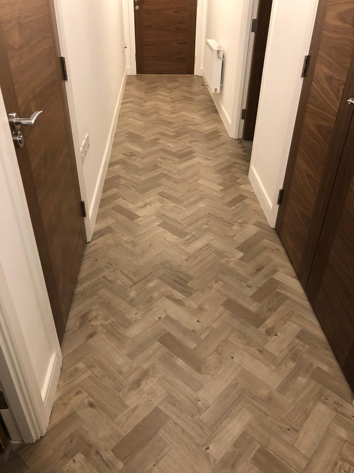 To supply & install Amtico Spacia Sun Bleached Oak luxury vinyl flooring in Kilburn 9
