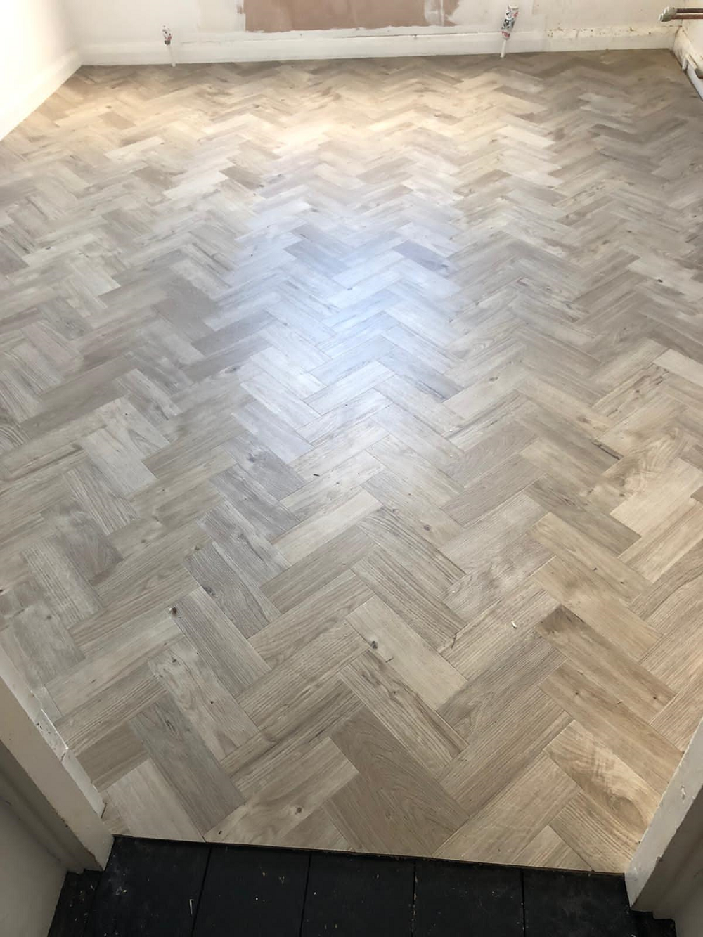 Amtico Spacia Sun Bleached Oak in a Parquet Design 1