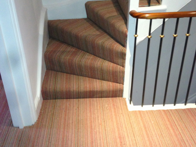multicoloured carpet stairs