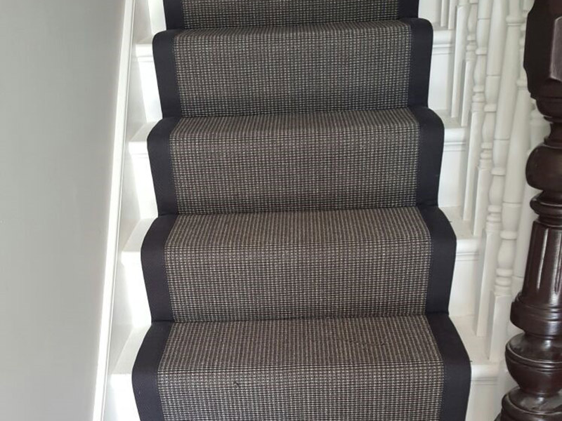 Black Carpet Runner With Black Border To Stairs The