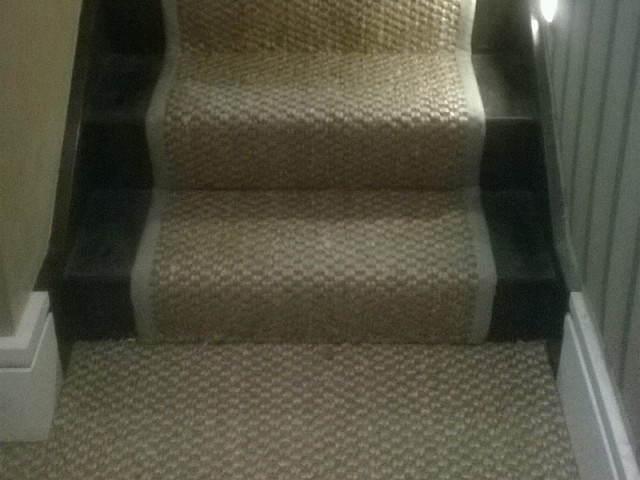 carpet as a runner to stairs with whipping